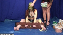 girl_trapped_in_stocks_and_sploshed_006