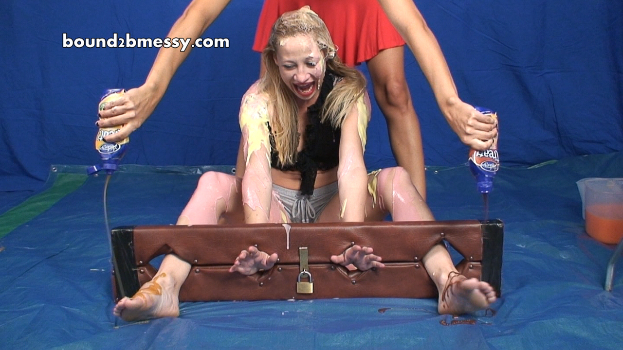 lizzie_trapped_in_stocks_and_sploshed_006